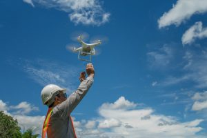man releasing drone for construction data